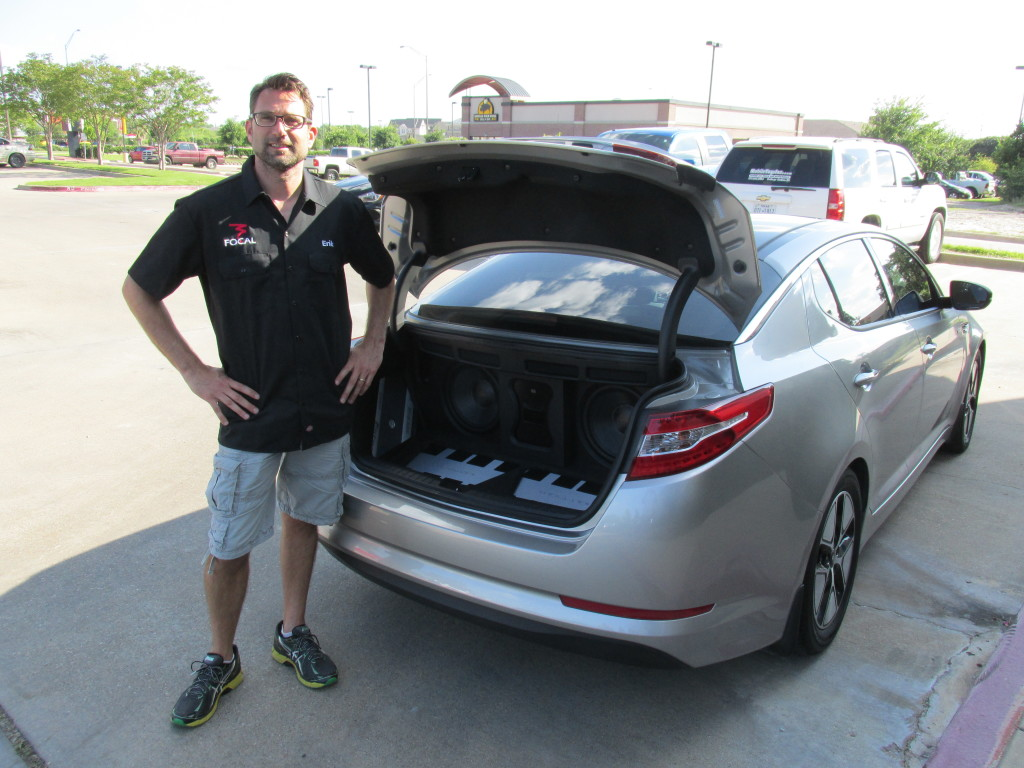 Erik Hansen, Kia Optima Hybrid 2013 Products Used: 1 Gladen Audio Aerospace 165.3, 2 Mosconi Zero 3 amplifiers, 2 Illusion Audio C12XL subwoofers, Black Hole Tile, Focal BAM